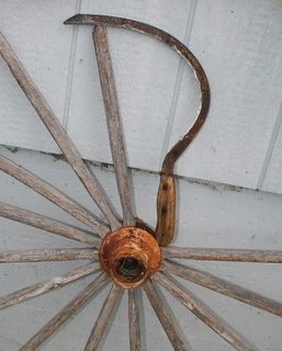 My trusty sickle and an old wagon wheel